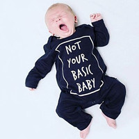 """ Not Your Basic Baby "" Long Sleeve Onesuit"