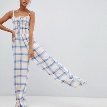 Wednesday's Girl cami jumpsuit with shirring in check at asos.com