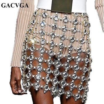GACVGA Sexy Metal Crystal Diamonds Skirt Women Shine Waist Chains Sequins Skirt Luxury Hollow Out Boho Party Outfits Clubwear