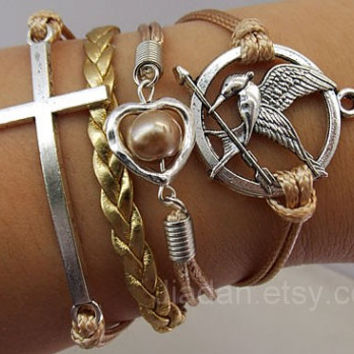 hunger bracelet,games bracelet,beads,Mockingjay pin,catching fire,couple,leather,fashion charm jewelry,heart,crosses,Champagne,Gold braid