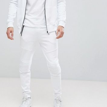 River Island Biker Joggers With Zip Detail In White at asos.com