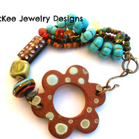 Ceramic, lampwork, Czech glass, wood, stone and metal Knotted Multi strand bracelet.