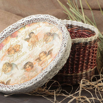 Handmade capacious round basket woven of paper tubes with lid with angel pattern