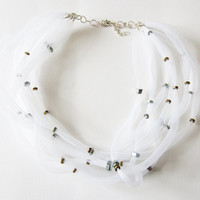 White BIB NECKLACE NYLON Tubular network. Choken black tubes and bolts