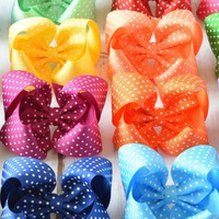 Large hair bows for girls and toddlers. 4 inch polka dot hairbows come in 29 fun colors on alligator clips, snap clips or barrettes