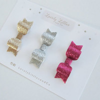 Gold, Pink and Silver Sparkle mini hair bow clip set on gold alligator clip. Suitable for all ages