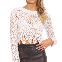 MORE TO LIFE CROP TOP - white crochet lace crop featuring long sleeves, a scalloped trim hemline and an exposed zip up back