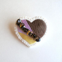 Heart brooch hand embroidered with colors of lavender yellow and chocolate brown with tiger eye beads on cream muslin and cream felt backing