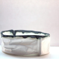 Crumpled paper looking white ring dish made out of English fine bone china with burn looking finish.