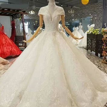 Ball gown wedding dresses short sleeves high neck open keyhole back shiny wedding gown