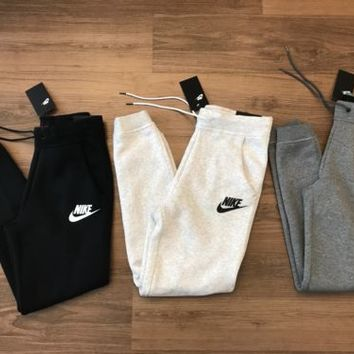 NIKE RALLY SWEATPANTS JOGGERS PANTS STANDARD FIT 828605 LOGO FLEECE SPORTSWEAR