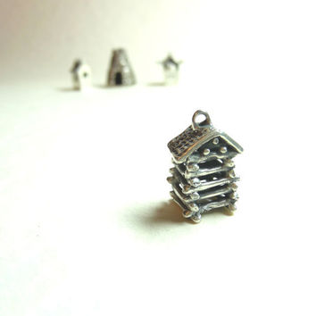 Log cabin pendant made by hand from fine silver