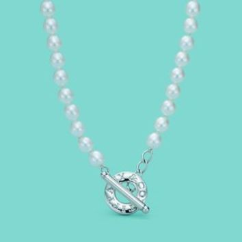 Tiffany & Co. -  Pearl necklace with sterling silver toggle.