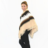 70s knit poncho.  Vintage cape. Knit shawl. Brown cream  white. Poncho with fringes. Fall fahion. Mad Men fashion.
