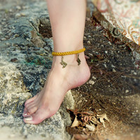 Yellow crochet anklet bracelet with dragon charm. Sexy foot jewelry