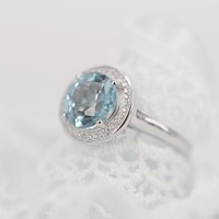 Magic Pieces Sterling Silver Ring with Big Round Natural Blue Topaz and CZ