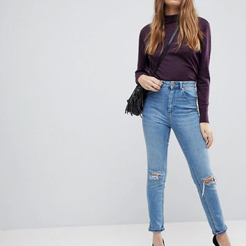 ASOS DESIGN Farleigh high waist slim mom jeans in light stone wash with busted knees at asos.com