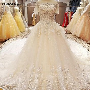 LS64210 wedding gowns 2017 with long train short sleeves ball gown transparent lace back bruidsjurken 2017 real photos