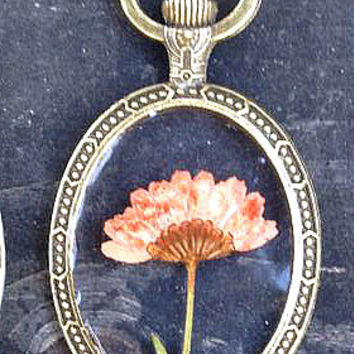 Pink Chrysanthemum Flower dried, pressed + Preserved in Clear Casting Resin set in an antique bronze oval frame pendant Necklace.
