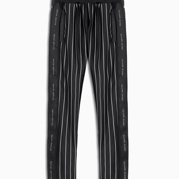 snap track pant / black stripe + black