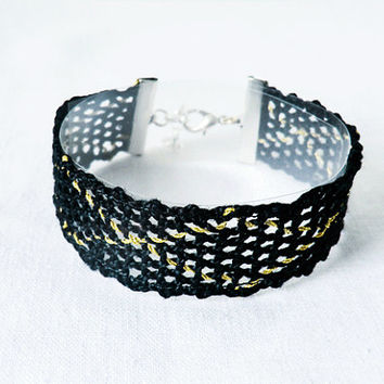 bracelet, handmade bobbin lace out of bead yarn,black and gold, silver fastener, laurinke no 1028