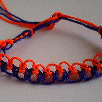 Dark blue and Neon Orange Macrame Bracelet .