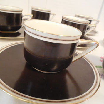"Demitasse Cup and Saucer Set, Royal Sphinx Maastricht, Made in Holland, N.A.S.M., 2"" Cups 5 1/4"" Saucers, Black, White with Gold Trim"
