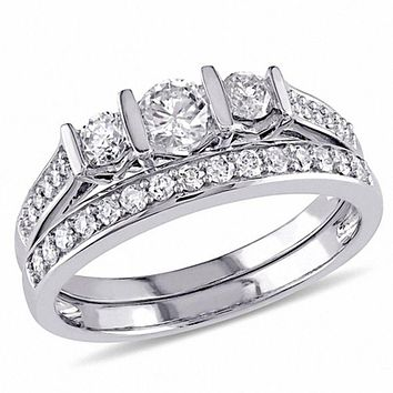 3/4 CT. T.W. Diamond Three Stone Bridal Engagement Ring Set in 14K White Gold