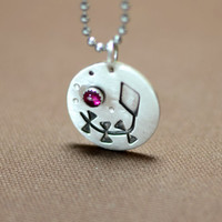 Kite in sterling silver with ruby shadowbox pendant