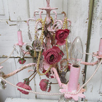 Pink distressed chandelier lighting crystals embellished roses romantic cottage up cycled home decor Anita Spero