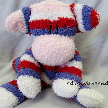 "Sockimamy  ""Vendella"" a sparkly pink, red, purple and white striped fuzzy sock monkey"