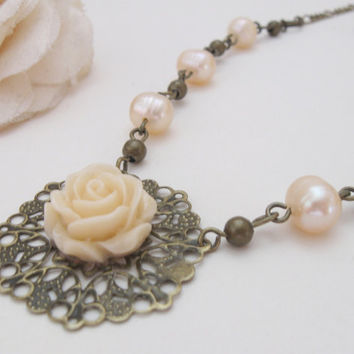 Vintage pearl necklace with antiqued brass filigree and ivory rose