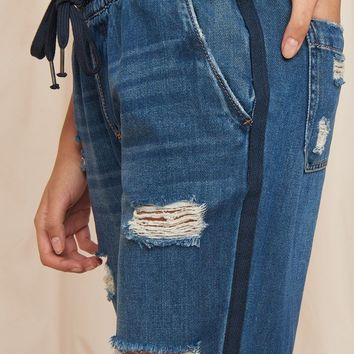 DISTRESSED DENIM JOGGERS