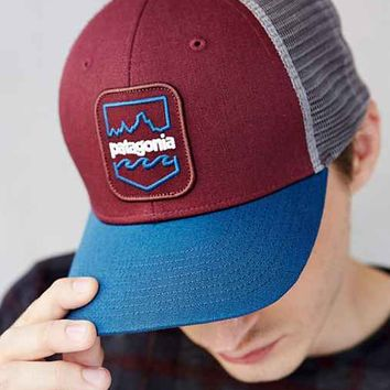 Patagonia Badge Patch Trucker Hat- Red from Urban Outfitters ca97dc7b90b
