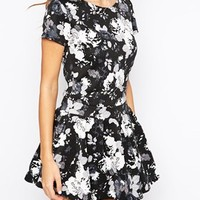 Club L Trumpet Drop Peplum Hem Dress in Mono Floral