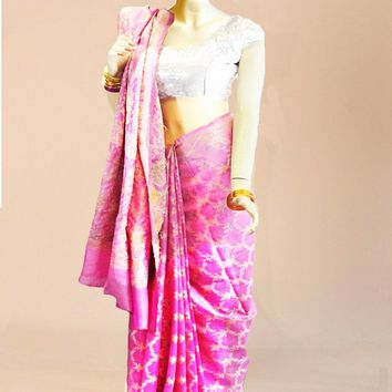 the pink khaadi silk saree heavily patterned with a gold base