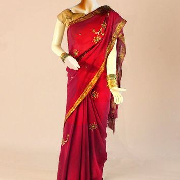 the pure crepe silk saree in raspberry and deep gold embroidery