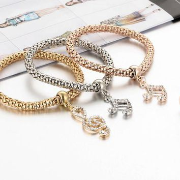 ONETOW Fashion simple hollow carved three - color set of music diamond crystal ring popcorn stretch bracelet