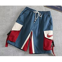 NIKE retro stitching contrast color overalls summer loose beach pants five pants F-AG-CLWM Blue