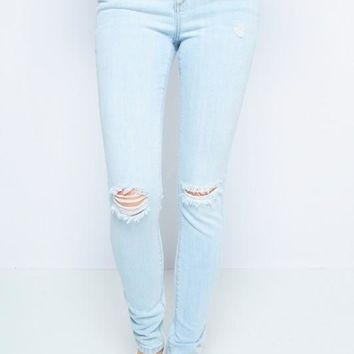 Light Distressed Knee Skinny