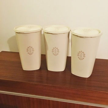 Vintage 1970s Set of Three (3) Large Cream / Beige Tupperware Kitchen Canisters with Servalier Press Lid / Retro Gold Motif on Canisters