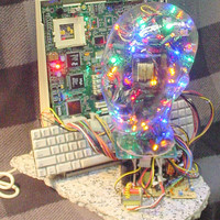 LED blinking glass head with computer motherboard and keyboard from apple