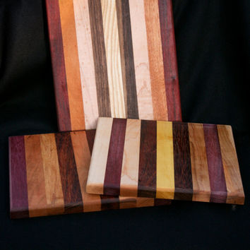 "cutting board/chopping block made of many different woods. 8 x 8.5"".  Other sizes available.  Random selection by maker"