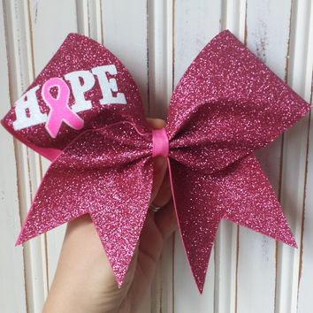 Hope breast cancer awareness bows made with pink, white and neon pink glitter.