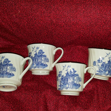 A Beautiful Set of Four Blue and White Coffee Cups With Asian Motif Made in Japan