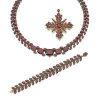 GOLD AND GARNET PARURE, 1820s | lot | Sotheby's