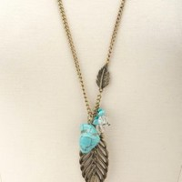 Turquoise & Leaf Charm Necklace by Charlotte Russe - Gold
