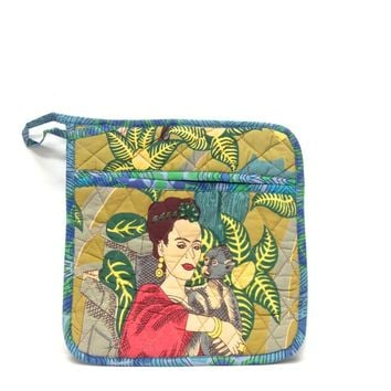Using this iconic Frida Kahlo pot holder in your kitchen table when you cook, featuring Frida Kahlo Tropical Ocre print at back, Frida Kahlo & Birds print throughout with a blue print colored border trimmed, quilted detailing with a layer of Insul-Brite th