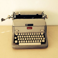 Royal Typewriter in Grey, White, and Red Works Perfectly Ready out of the Box