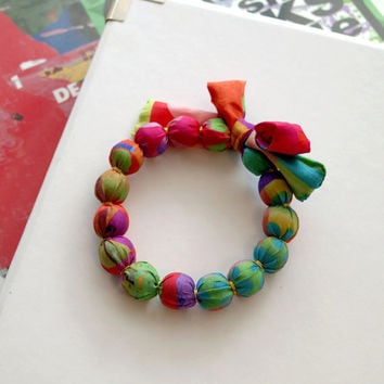 Silk bracelet, handmade fabric beaded jewelry with original design made by the artist